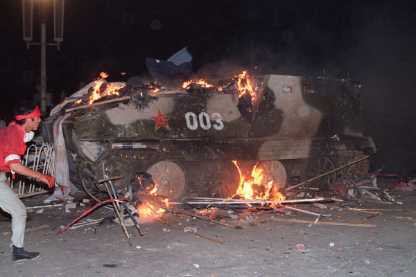 An armored vehicle in flames during the June 4, 1989 protests in Beijing