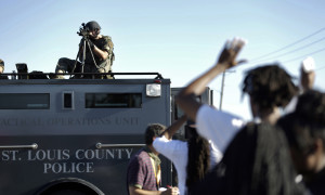 Police take aim at protesters in Ferguson