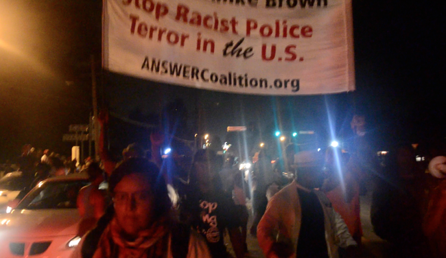 Photo of Ferguson, Mo. – Hands up, don't shoot-Justice for Mike Brown (video)