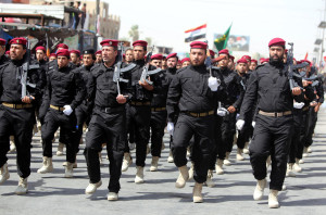 Members of the newly established Shiite militia 'Peace Brigades' parade in Baghdad's Sadr city, Iraq, 21 June 2014. Hundreds of thousands of Shiites paraded in Baghdad and several other Shiites cities in Iraq, in a show of force to display their readiness to fight Sunni extremists who have taken control of key areas in northern and western Iraq. he jihadist Islamic State in Iraq and the Levant (ISIL) seized the northern city of Mosul in a blitz last week and then moved on to capture a string of towns stretching south towards Baghdad.  EPA/ALI ABBAS