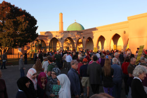 image - abq peace walk to islamic center - crowd with mosque temple