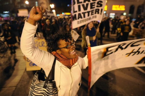 A protester in Oakland, Calif., exemplifies the mass anger that is pushing the movement forward.