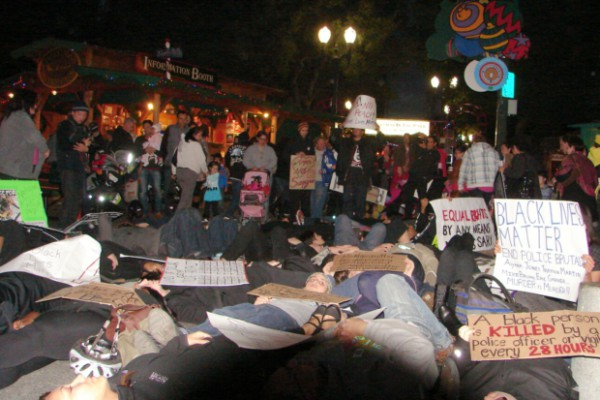 Die-in at 'Christmas in the Park'. Photos: Jon Britton