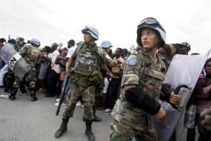"Uruguayan UN soldiers in Port-au-Prince during a food distribution in 2010. Increasingly, Uruguay has exported its soldiers as ""political goods"" to assist ""democratic colonialism."" Credit: Marco Dormino/UN Photo"