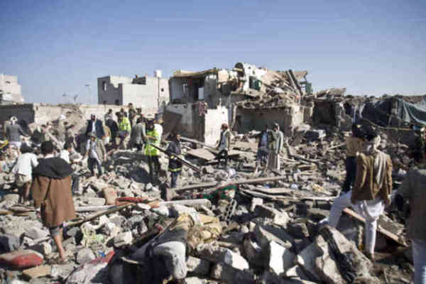 People search for survivors under the rubble of houses destroyed by Saudi airstrikes near Sanaa Airport, March 26.