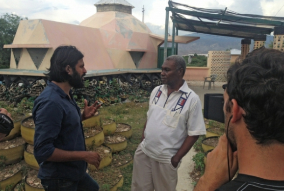 HBO's Vice correspondent Vikram Gandhi (left) interviewing Haitian economist Camille Chalmers in Haiti. Vice sharply criticizes the shortfalls of U.S. aid in Haiti.