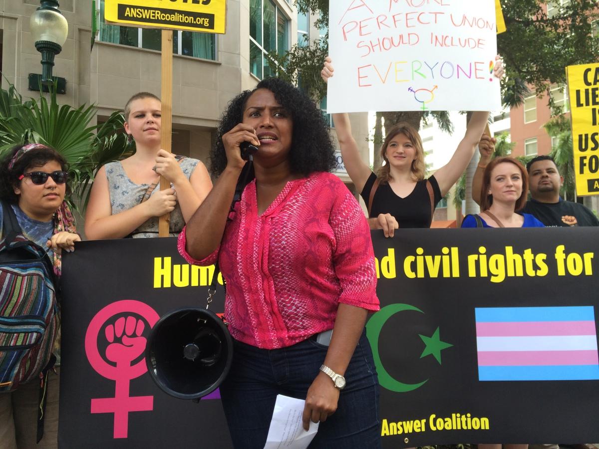 Photo of Sarasota activists protest Ben Carson book signing