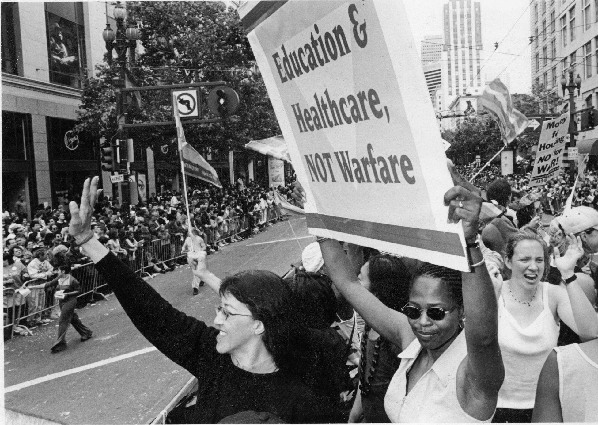 Photo of Clinton's hypocrisy on LGBTQ equality vs. Gloria La Riva's record of struggle