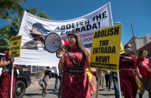 Red Nation member and San Ildefonso Pueblo tribal member Jennifer Marley on bullhorn
