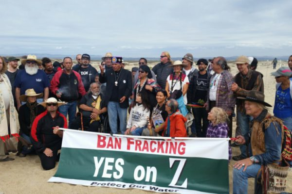 Dennis at Salinas National Wildlife Refuge, center, with black hat, speaking in support of Measure Z to ban fracking and new oil-well development. | Photo: Estevan Hernández