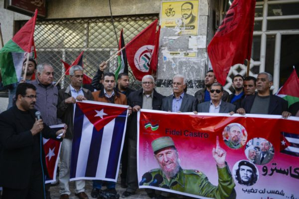 Palestinian People's Party supporters held posters and the National flag of Cuba during a commemoration ceremony of Fidel Castro in front of Shawwa Husary tower in Gaza City, Gaza on November 27, 2016. | Photo: Mustafa Hassona, Anadolu Agency