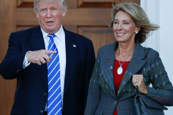 President-elect Donald Trump and Betsy DeVos pose for photographs at Trump National Golf Club Bedminster clubhouse in Bedminster, N.J. | Photo: AP Photo/Carolyn Kaster