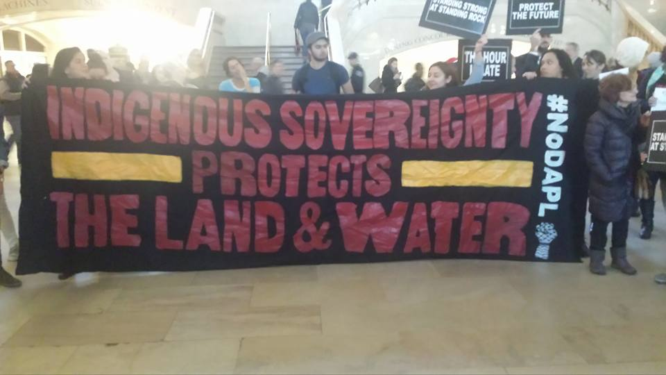 Photo of NYC: From block to block, protesters stand with Standing Rock