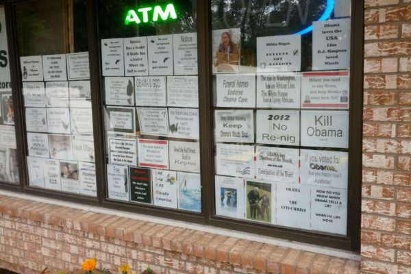Racist signs in window of New Mexico store