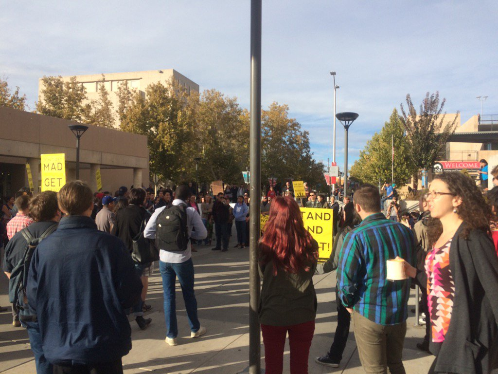 Photo of UNM students walk out against Trump.