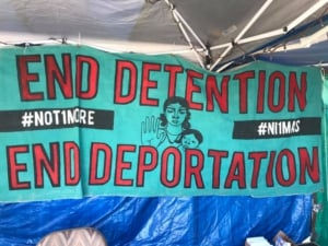 Banner: End Detention, End Deportation #not1more