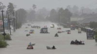 Civilian rescue boats rescue Houston residents stranded by the storm.