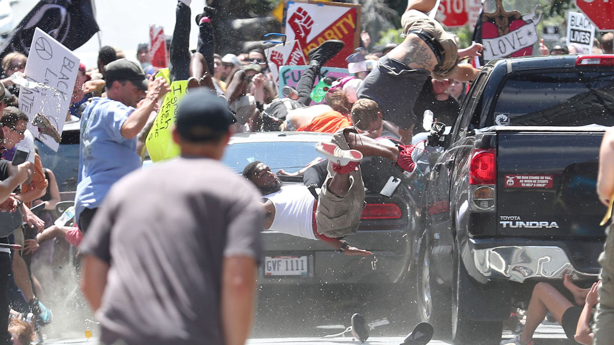 Armed white supremacists attack and mace peaceful group of protestors in Charlottesville