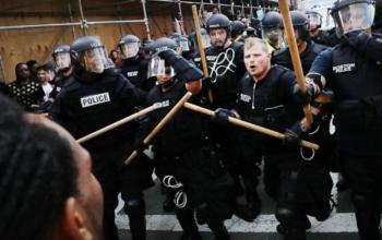 Boston police attacking anti-fascists on Aug. 19.