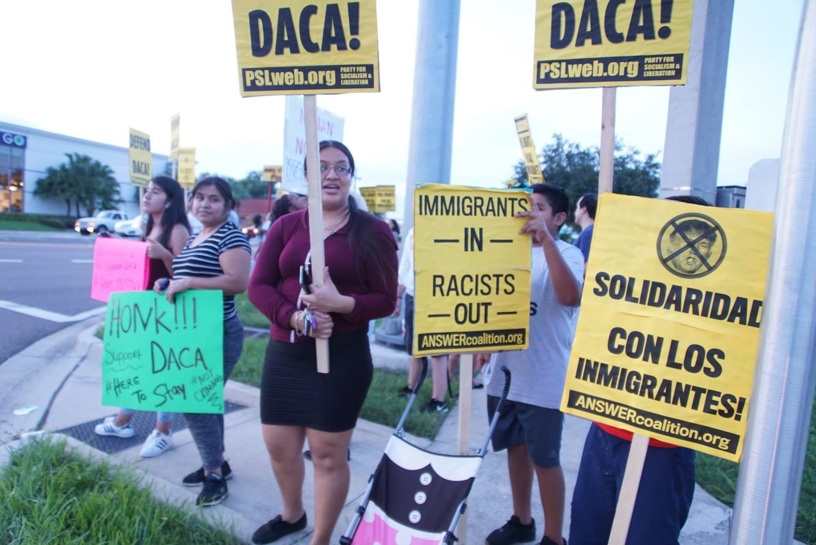 """Photo of Bradenton rally for Dreamers: """"Defend DACA! Immigrants are here to stay!"""""""