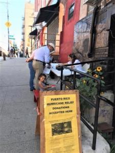 Collecting donations in el Barrio.