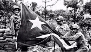 Borinqueneers with Puerto Rican flag, which they later were forced to relinquish.