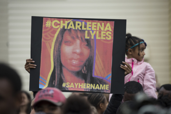 A woman holds a sign in honor of Charleena Lyles during a protest and rally in honor of Lyles on June 20, 2017 in Seattle, Washington.