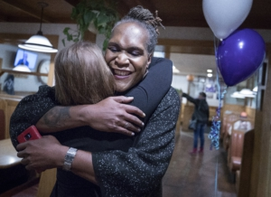 Andrea Jenkins hugs a supporter as she wins the Minneapolis Ward 8: Council Member race in Minneapolis.