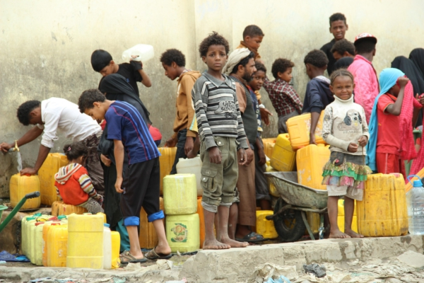 Photo: Children collecting water in Sana'a, Yemen, July 2015. Credit: Hind Aleryani/Oxfam