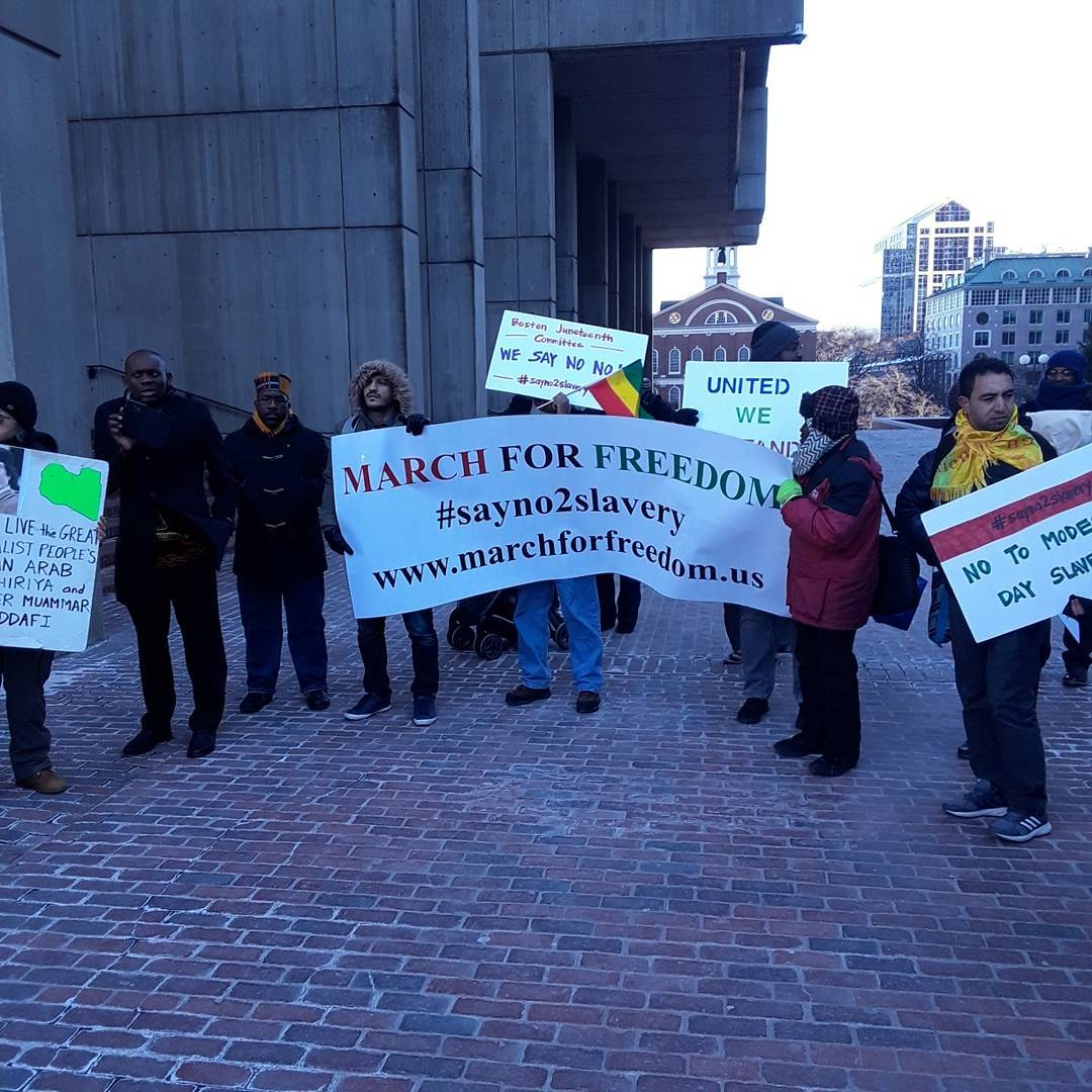 Photo of Boston activists say: Libyan slavery, made in the USA!