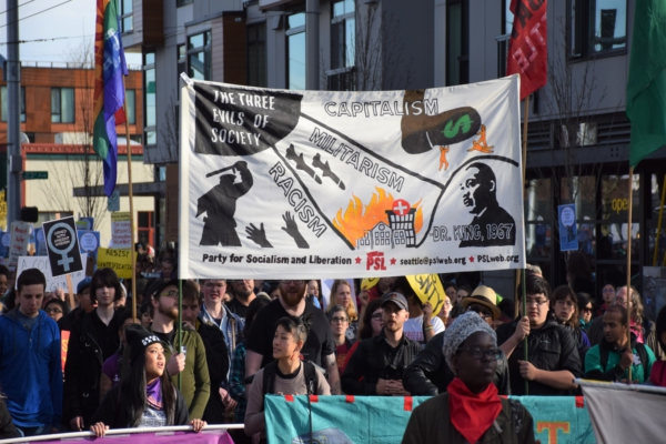 PSL banner at Seattle MLK Day 2018, depicting the