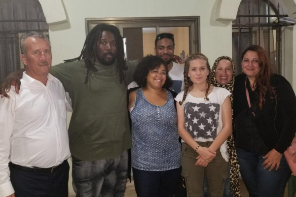 Photo: Author at center front center, next to Ahed. She is with the Tamimi family and other members of solidarity delegation.