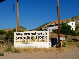 Message of solidarity seen in Pilar, a small town in New Mexico's Embudo Valley, an area with a rich history of land and water activism. Liberation photo: Karina Rodgers
