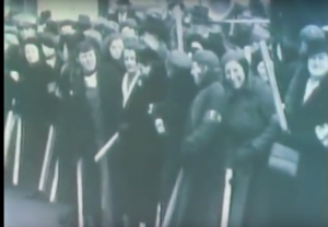 "Women defend male sit-down strikers in Flint Michigan 1937. (Screen shot from documentary ""With Babies and Banners"")"