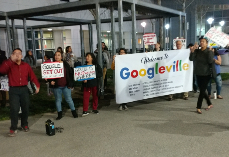 Photo of Protesters at San José's State of the City call out economic inequality and corruption regarding potential Google development