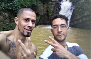 Max Evans Aguayo and Richard Lopez at a waterfall in Naranjito. The water used be blue but is now brown. Residents warned not to swim there. Liberation News photo
