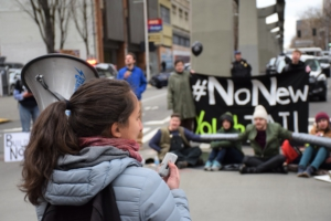 A NNYJ activist criticizes the cost and harm of the youth jail project.. Liberation photo: Lee Hessler