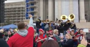 "Music teachers' Walkout Band plays ""We're not gonna take it!"" Screenshot of video by Jordan Faith Nguyen."
