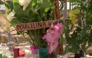Roadside memorial for SantosHilario Garcia and Marcelina Garcia-Perfecto. Screen shot of KGET footage.