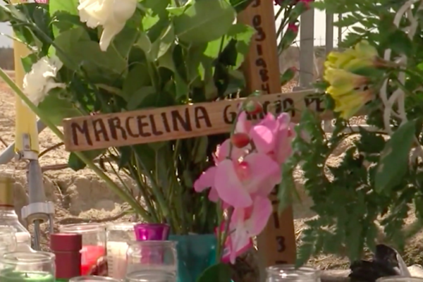 Roadside memorial for Santos Hilario Garcia and Marcelina Garcia-Perfecto. Screen shot of KGET footage.
