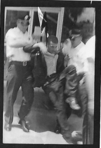 Being arrested at Crow's drugstore in Albany, Georgia. Photo: Danny Lyon.