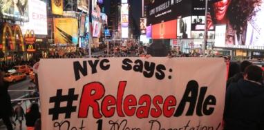 New York City banner drop at Times Square. Photo: Oscar Diaz.