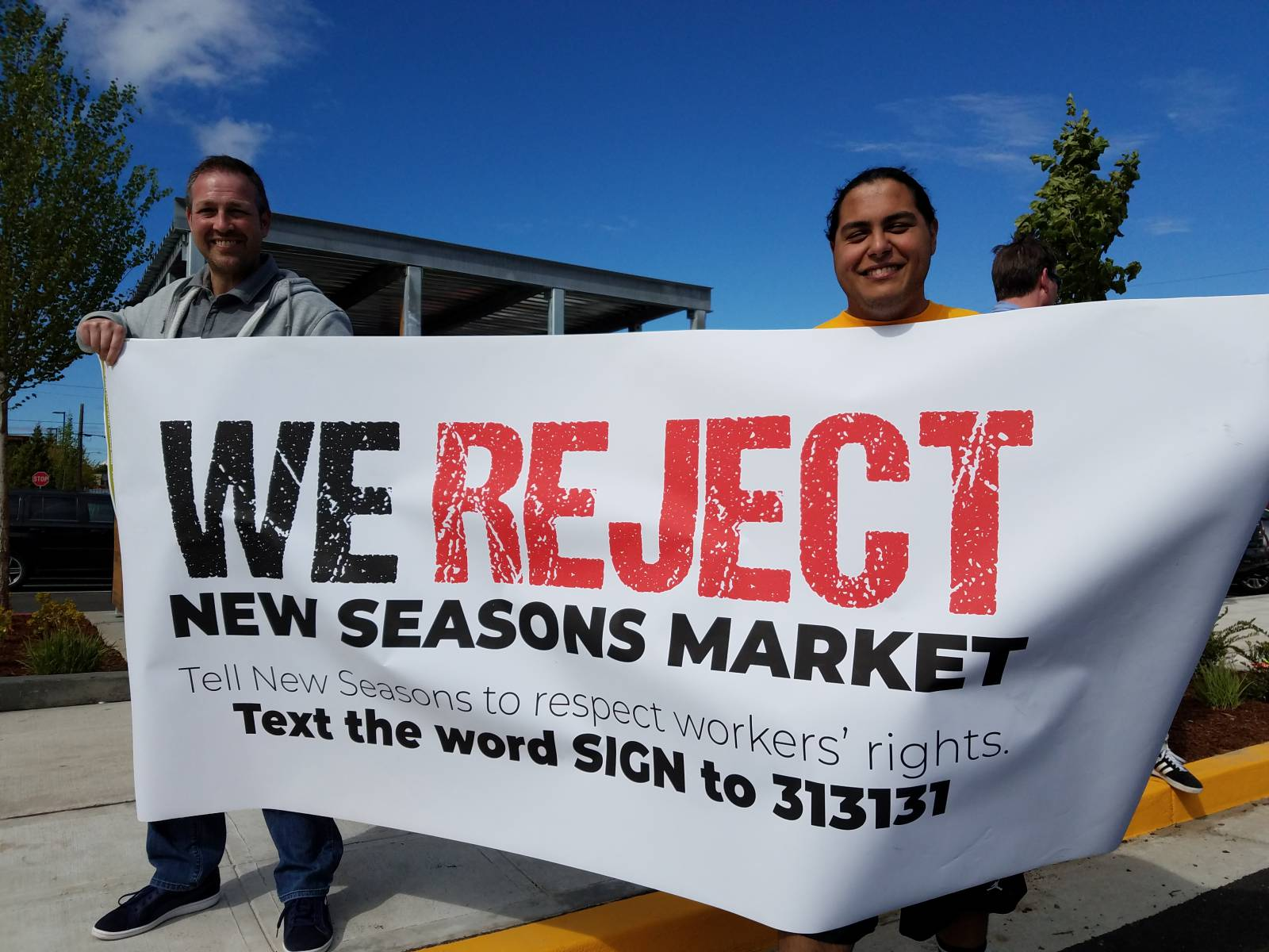 Seattle union workers hold day of action to protest New Seasons Market
