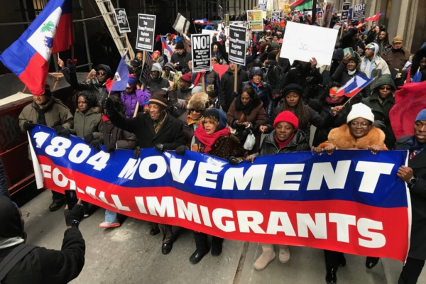 On Jan. 19, some 1,000 marched on the Trump Building at 40 Wall Street to demand permanent residency for TPS holders. Credit: Kim Ives/Haïti Liberté