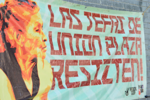 Poster hanging in Duranguito made by Radical Soup and Paso Del Sur. Liberation photo