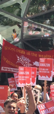 """""""Tax Amazon"""" march, Seattle, May 12. Marchers outside Amazon's headquarters in South Lake Union. Liberation Photo."""