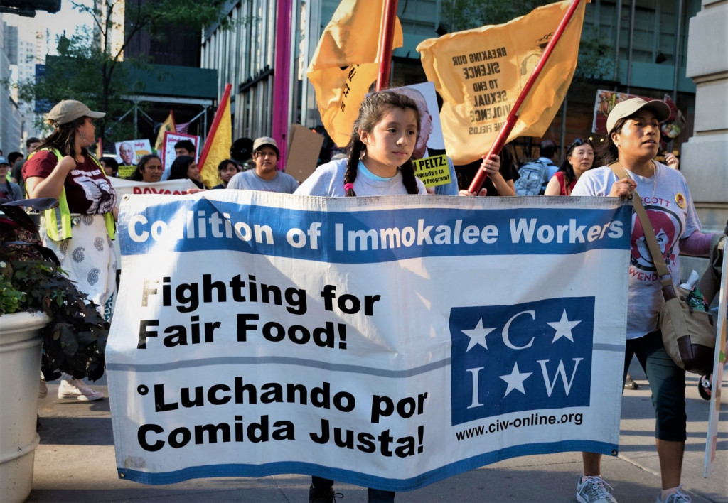 Some 40 farm workers and their families came from Florida to demonstrate outside the offices of Wendy's Board Chairman. Liberation photo: Vincent Tsai.