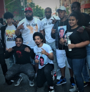Junior's friends pose with rappers who had come to perform at the shrine. Photo: Elias Alicea.