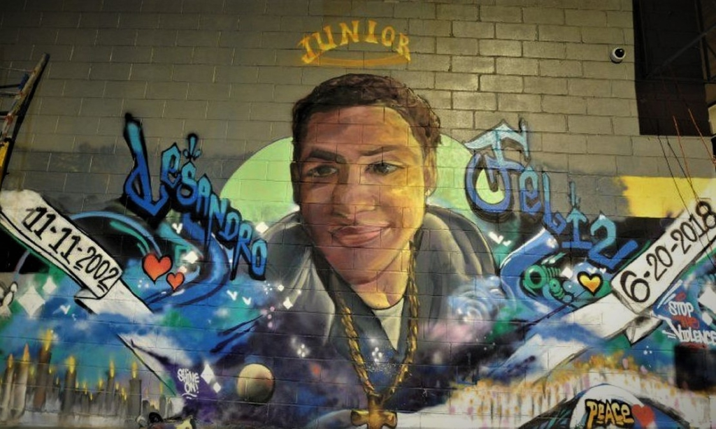 One of several street murals honoring Junior. Liberation News Photo