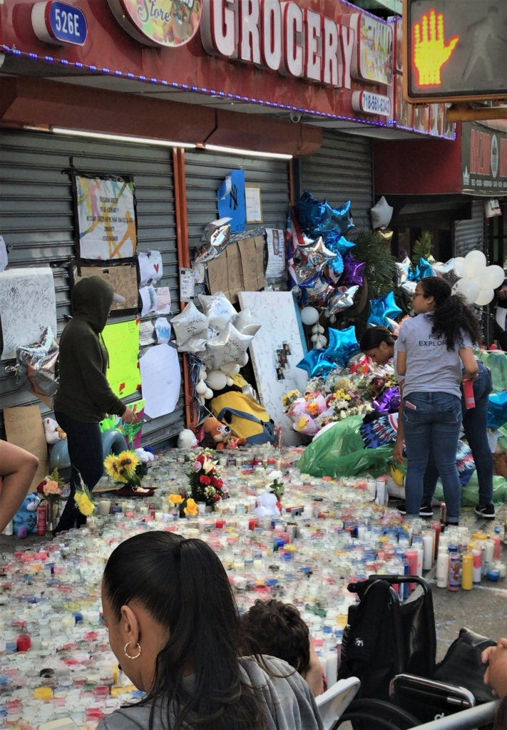 A small part of the shrine neighbors have built for Junior. Ceremonies honoring him are held here every day. Photo: Elias Alicea